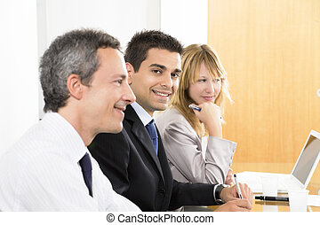 Portrait of business man among colleagues in meeting
