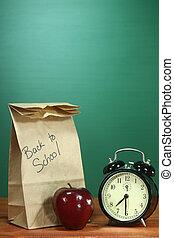 bureau scolaire, pomme, déjeuner, horloge