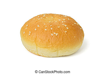 Burger bun with white sesame seeds isolated on a white with clipping path
