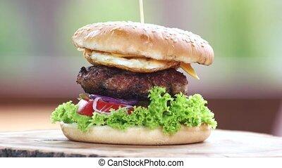 Burger close up. Bun, vegetables and beef.