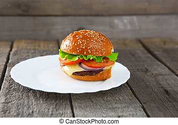 Burger in a white plate on table