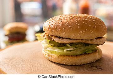 Burger on a wood board.