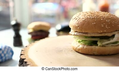 Burger on a wooden board.