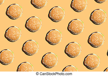 Burger pattern on a yellow background. Top view.