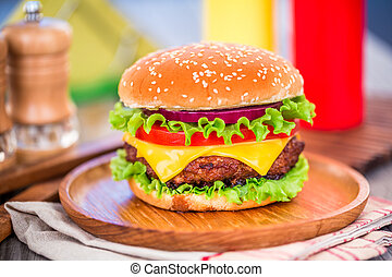 Burger - Tasty and appetizing hamburger cheeseburger