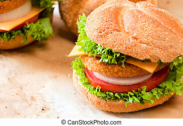 Burger time - Close up to fishburger and fresh vegetables