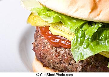 burger time - nice big juicy hamburger on a white plate