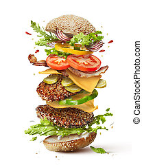 burger with flying ingredients - Delicious monster burger...