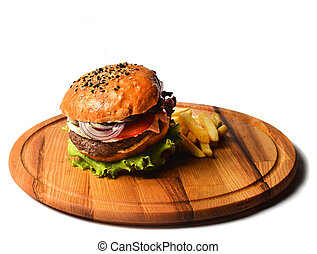 Burger with french fries on a wooden board. Fast food isolated on white background.