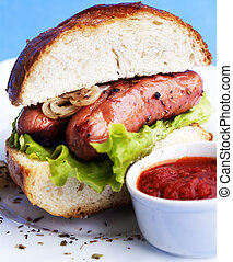 Burger with fried sausages