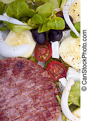 Burger with garrison - Grilled burger with colorful salad as...