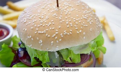 Burger with meat and vegetables spinning - Burger with meat...