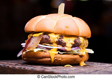 Big cheeseburger with melted cheese