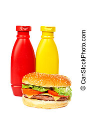 Burger with mustard and ketchup bottles