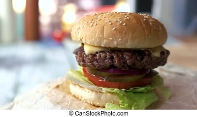Burger with sesame seeds. Grilled cheese and meat. Fast food...