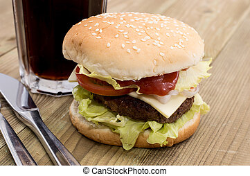 Burger with Softdrink on a wooden table