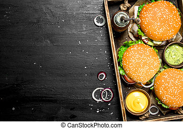 Burgers on an old tray.