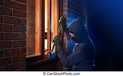 Burglar breaking in