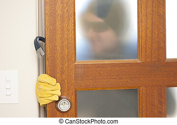 Burglar breaking in house with crowbar - Burglar, thief with...
