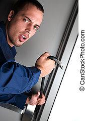 Burglar breaking into a building using crowbar
