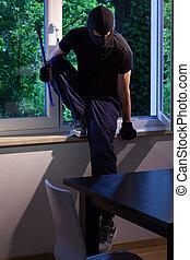 Burglar enters of someone's house