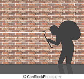 Burglar in front of brick wall