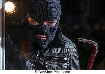 Burglar, looking at