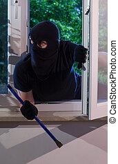 Burglar looks around the apartment