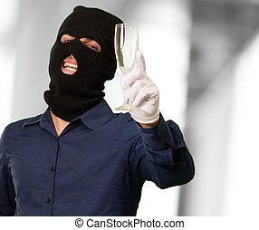 Burglar Man Holding Champagne Glass