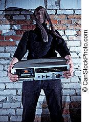 Burglar stealing electronics - Burglar disguised with...
