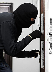 burglar thief at house breaking - Thief Burglar opening...