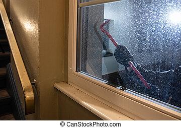 Burglar Trying To Open Window With Crowbar