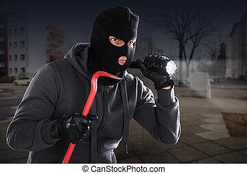 Burglar With A Crowbar And A Flashlight