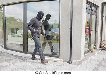 Burglar with crow bar - Burglar with crowbar outside home