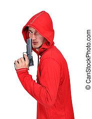 burglar with gun - young burglar with gun on a white...