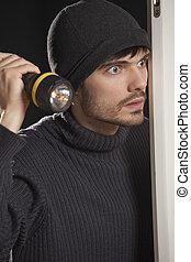 burglar with pocket lamp