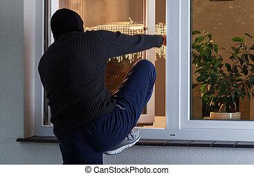 Burglary into the house - Horizontal view of burglary into ...