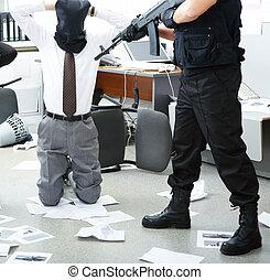 Burglary - Photo of kneeling businessman wearing black sacks...