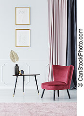 Burgundy chair by the table