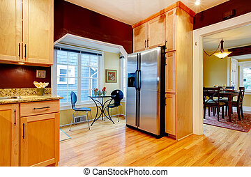Burgundy kitchen room with dining area