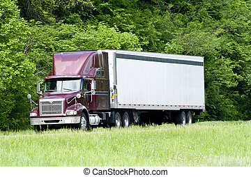 Burgundy Tractor-Trailer Rig On The Interstate In...