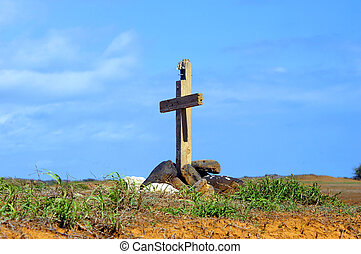 Burial on Big Island - Cross propped up by large rocks...