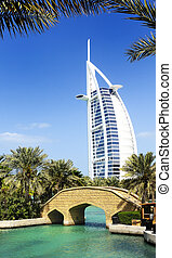 View at hotel Burj al Arab from Madinat Jumeirah in Dubai. Madinat Jumeirah encompasses two hotels and clusters of 29 traditional Arabic houses. United Arabe Emirates