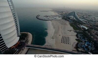 Burj Al Arab hotel in Dubai, UAE. Helicopter view - Fly over...