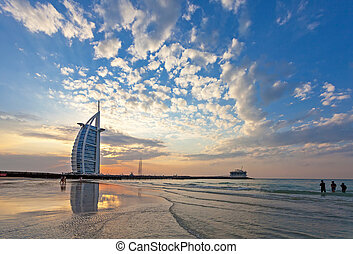 DUBAI, UAE, JANUARY 2010: Burj Al Arab on Jumeirah Beach after a big thunderstorm. After the storm all what remains are spectacular clouds in the sky. New Years Day January 01, 2010