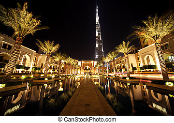 Burj Dubai, night Dubai street with palms and pool general...