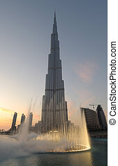 Burj Khalifa and Dubai Fountain at dusk. Dubai United Arab...