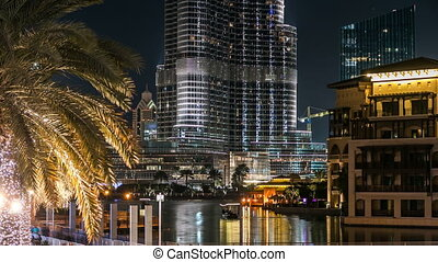 Burj Khalifa and Dubai Fountain at night timelapse. The...