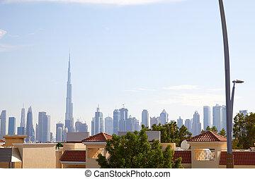 Burj Khalifa skyscraper, Dubai skyline and residential houses in a sunny day in United Arab Emirates