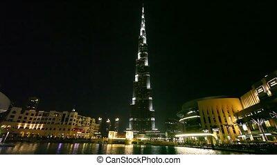 Burj Khalifa, tallest building in the world, and Burj Dubai Lake at night in Dubai, UAE.